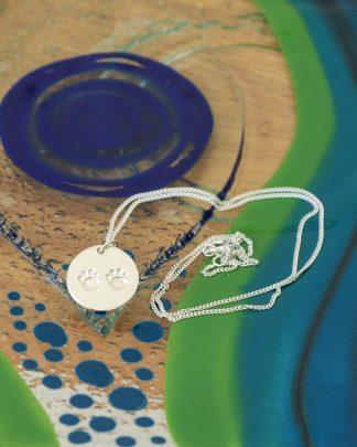 Silver paw print pendant
