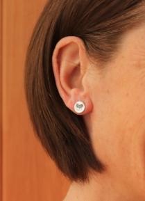 Close up bat earrings in ears