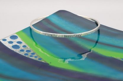 Linear hammered bangle